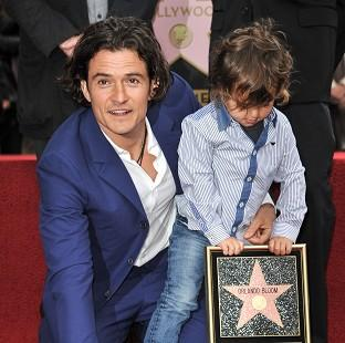 Salisbury Journal: Orlando Bloom and son Flynn see his star on the Hollywood Walk Of Fame unveiled (AP)