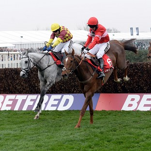 Silviniaco Conti and Noel Fehily, right, win the Betfred Bowl at Aintree