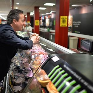 Salisbury Journal: Prime Minister David Cameron meets staff and shoppers at Asda in Clapham, south London