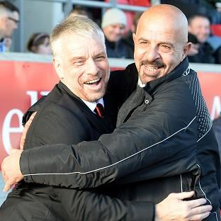 Salford owner Marwan Koukash, right, has given outgoing coach Brian Noble, left, 48 hours to accept a role as director of football