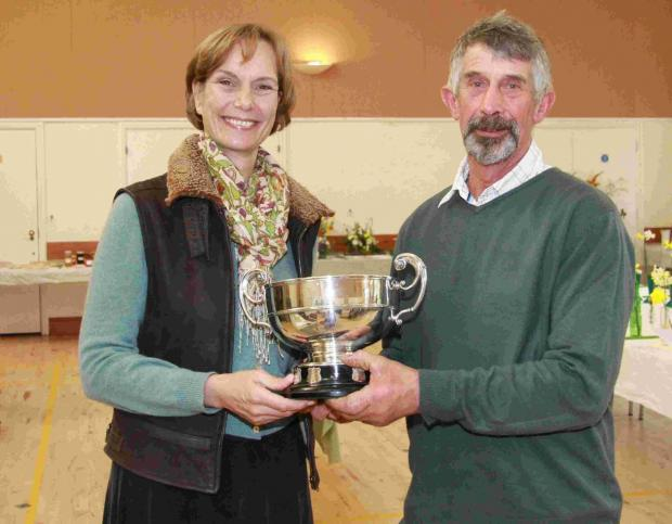John Godber, winner of the Challenge Cup for best exhibit in floral arts classes, with society president Jane Hall. Lots more pictures in the Journal of April 10