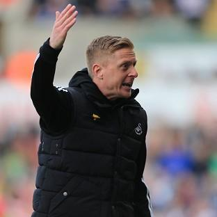 Swansea manager Garry Monk, pictured, cut a frustrated figure after defender Chico Flores was sent off in Sunday's 1-0 defeat to Chelsea