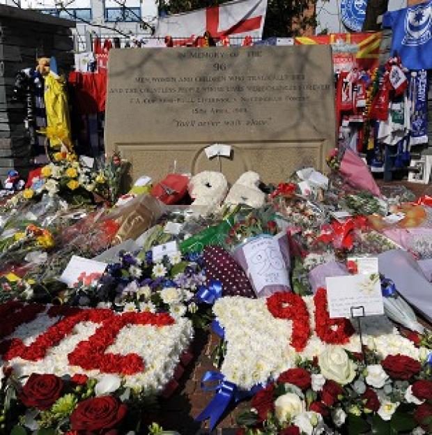 Salisbury Journal: Floral tributes were left at Hillsborough and Anfield