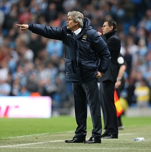 Manuel Pellegrini admits Manchester City have a tough task to win the Premier League