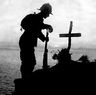 Salisbury Journal: A soldier pays his respects at the grave of a colleague near Cape Helles, where the Gallipoli landings took place
