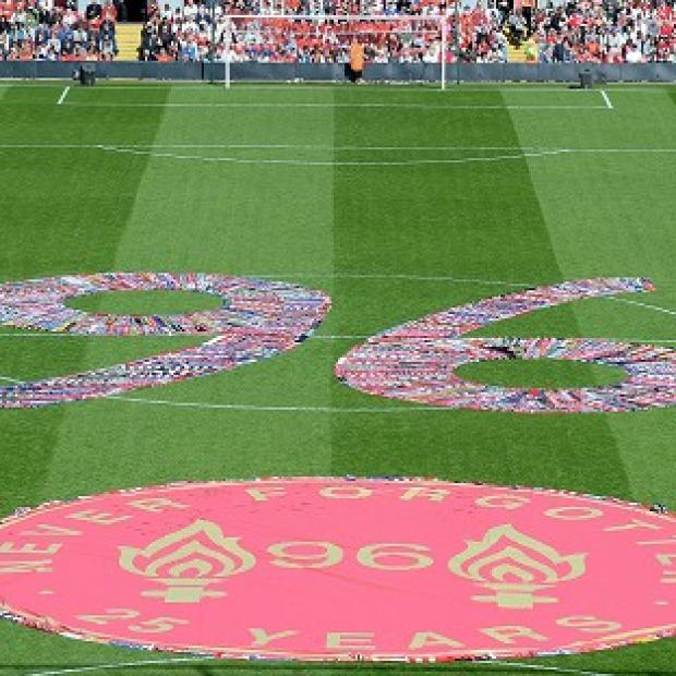 Salisbury Journal: Fans' scarves make up a 96, filling the centre circle before the Hillsborough 25th Anniversary Memorial Service at Anfield Stadium, Liverpool