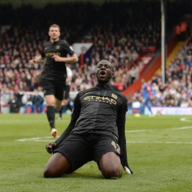 Salisbury Journal: Yaya Toure celebrates after scoring
