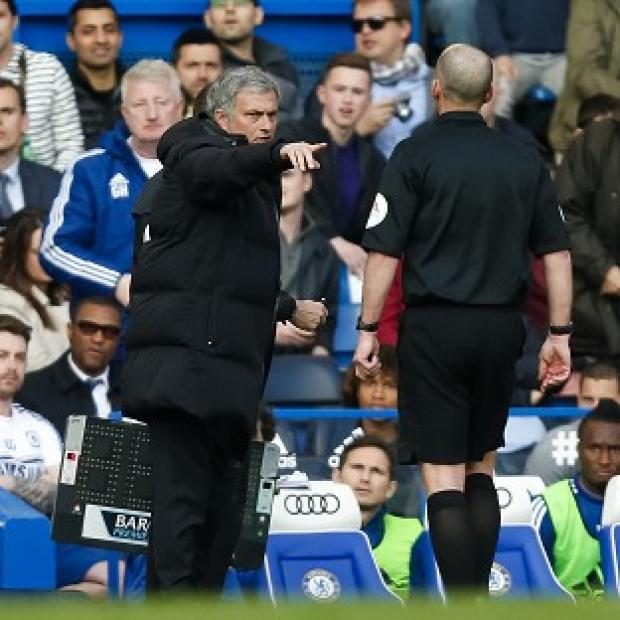 Salisbury Journal: Jose Mourinho, centre, was unhappy with referee Mike Dean, right, during Chelsea's defeat to Sunderland