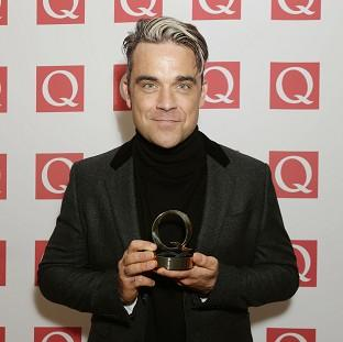 Robbie Williams won't feature on Take That's latest album and may only pop up as a guest on the band's tour