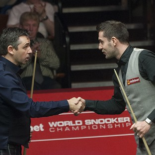 Mark Selby, right, is the first man through to the semi-finals in Sheffield