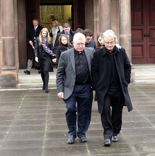 Salisbury Journal: The husband of Ann Maguire, Don Maguire (right), leaves Corpus Christi church, Leeds, with Deacon Sean Quigley (left)