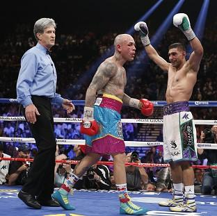Amir Khan, right, was impressive in victory over Luis Collazo (AP)