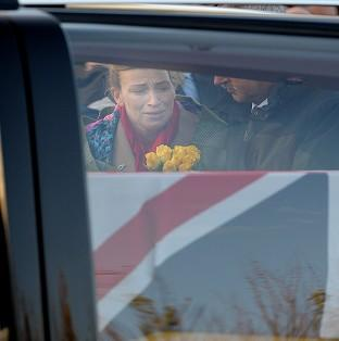 Salisbury Journal: Emma Fisher, the widow of Warrant Officer Class 2 Ian Michael Fisher, as the cortege passes