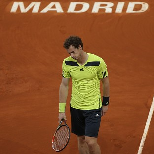 Andy Murray suffered a 6-3 6-2 defeat to Santiago Giraldo in Madrid (AP)