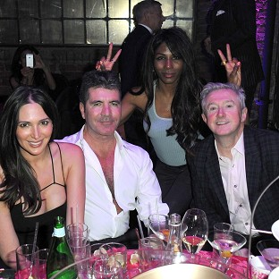 Simon Cowell enjoyed a night out at a cabaret club with Lauren Silverman, Sinitta and Louis Walsh (Rex)