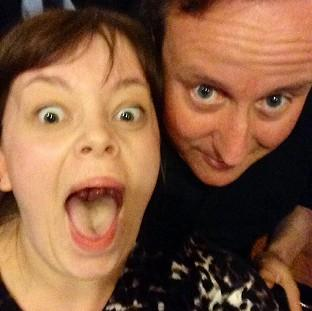 Salisbury Journal: Prime Minister David Cameron poses for a selfie with Becky Smith in Nandos, Park Street, Bristol, during a visit to the city. (Becky Smith/PA)