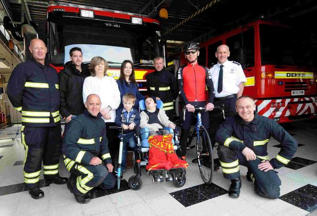 Salisbury Journal: Jayden Beaven and his family with firefighters at Salisbury Fire Station. DC5006P1