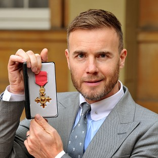 Gary Barlow has faced calls to hand back his OBE over claims he invested in a tax avoidance scheme