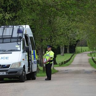 Police at the gate to Down Hall Country House Hotel in Hatfield Heath, Essex, where a couple were found dead in a swimming pool