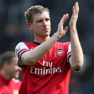 Per Mertesacker is determined to give Arsenal fans something to celebra