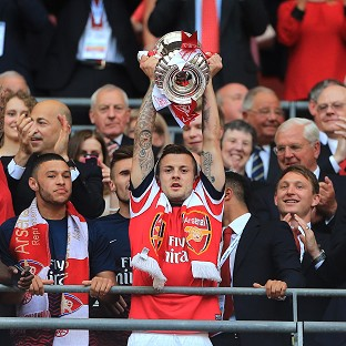 Jack Wilshere, centre, finally tasted success with Arsenal
