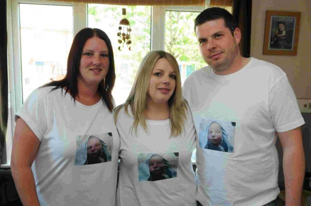 Family stage walk for baby's headstone