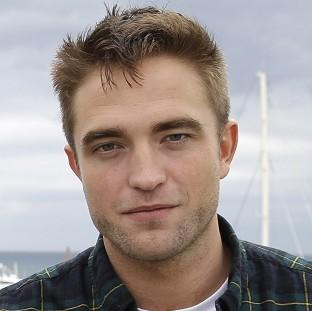 Robert Pattinson is in Cannes promoting The Rover and Maps To The Stars