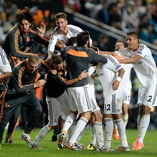 Marcelo is mobbed after scoring Real Madrid's third goal