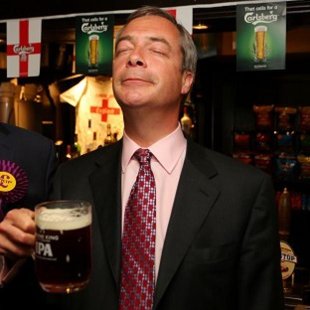 Salisbury Journal: Ukip leader Nigel Farage enjoys a pint in the Hoy and Helmet pub in South Benfleet, Essex, as his party makes election gains
