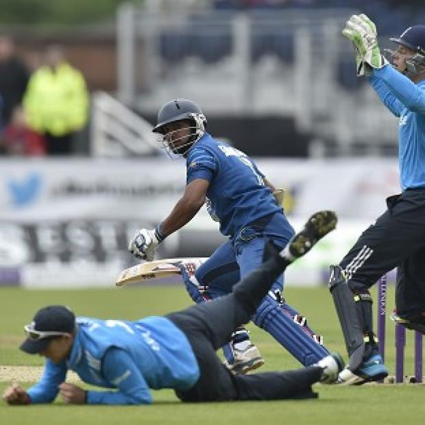 Salisbury Journal: Joe Root, on the floor, and his England team-mates were handed a heavy defeat by Sri Lanka