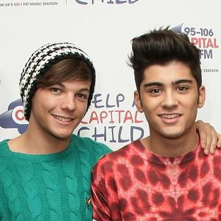 "Salisbury Journal: One Direction members Louis Tomlinson and Zayn Malik are reportedly heard joking about ""illegal substances"" in a video"