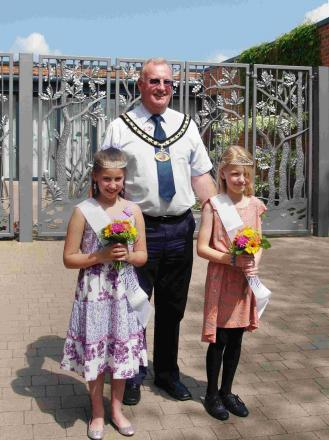 Chloe Butler, 11 from Ringwood Junior School, and Laura Haskett, 10 from Poulner Junior School with Cllr Steve Rippon-Swaine