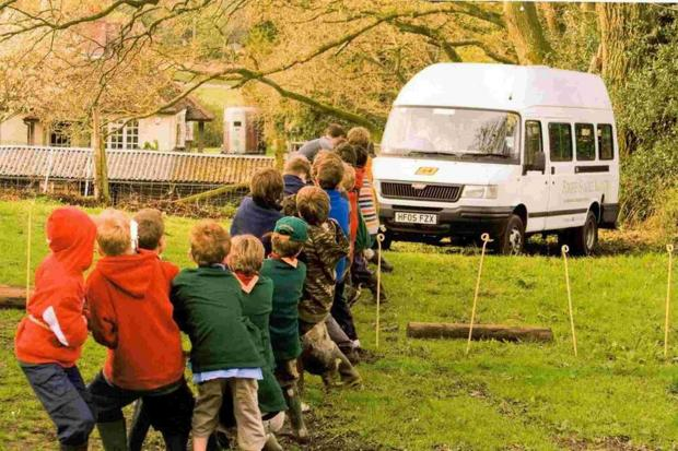 Cubs pull their minibus from the mud