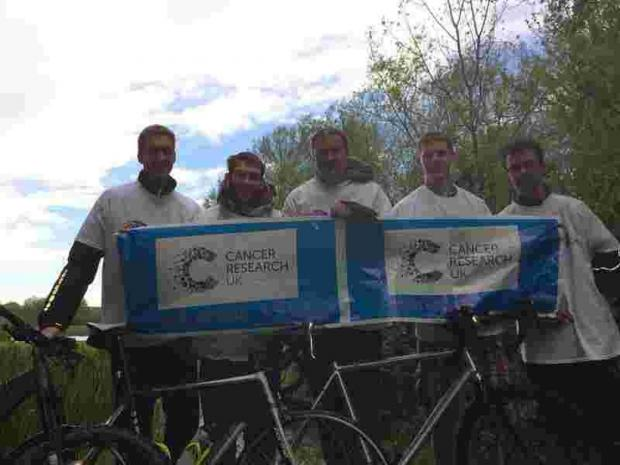 Five men, four counties, three charities, two wheels, one way west...