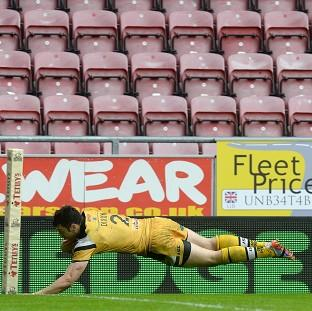 Kirk Dixon scores the all-important try that gave Castleford victory