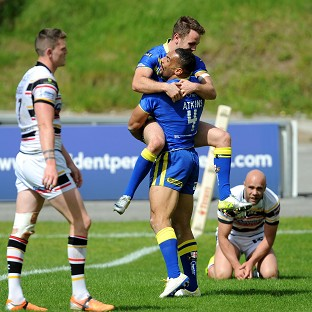Ryan Atkins celebrates with Richie Myler after scoring a try