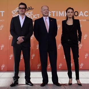 Salisbury Journal: Foreign Secretary William Hague (centre), Brad Pitt and Angelina Jolie arrive at the End Sexual Violence in Conflict Summit at the Excel centre in east London.