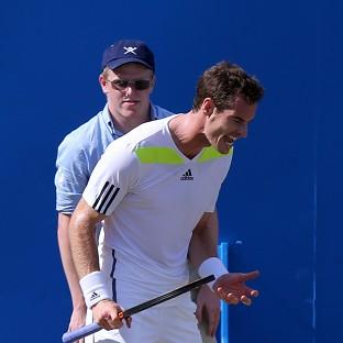 Andy Murray is confident he can defend his Wimbledon title despite crashing out early at Queen's