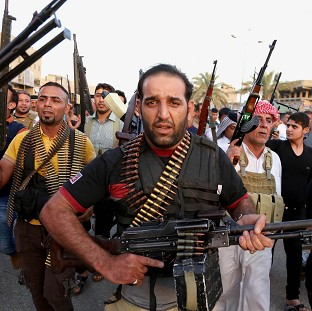 Iraqi Shia tribal fighters deploy with their weapons while chanting slogans against the al-Qaida-inspired Islamic State of Iraq and the Levant (AP)