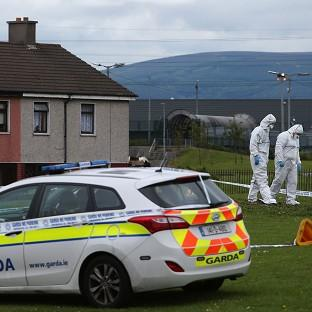 Salisbury Journal: Members of the Garda forensic team at the crime scene in Croftwood Gardens, Dublin, where a six-year-old boy was shot