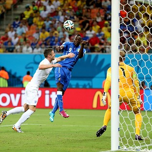 Mario Balotelli scores Italy's second goal in their World Cup opener with England