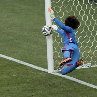 Mexico goalkeeper Guillermo Ochoa makes a save from Neymar. (AP)