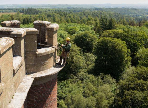 Stonemasons go 160ft up to carry out tower survey