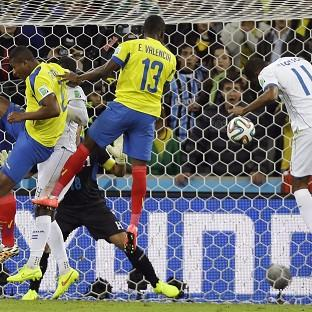 Ecuador's Enner Valencia heads home the winning goal (AP)