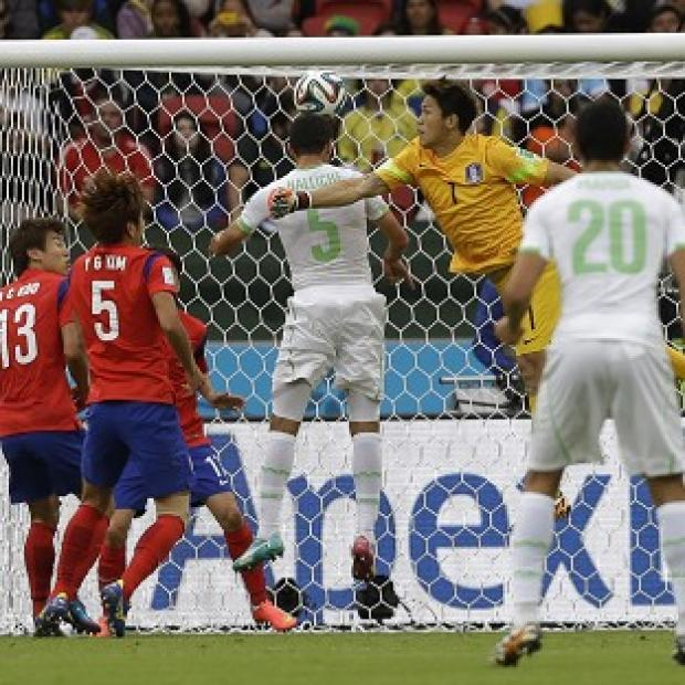 Salisbury Journal: Rafik Halliche, centre, scores Algeria's second goal in the 4-2 win over South Korea. (AP)