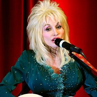 Dolly Parton has praised her goddaughter Miley Cyrus for demonstrating female empowerment