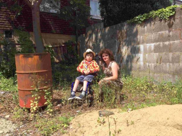 Lorraine Tarrant Heckford with Jon in their overgrown garden