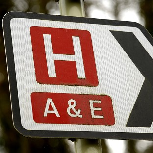 General view of a road sign for a hospital and Accident and Emergency department.