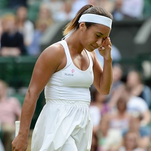 Great Britain's Heather Watson bowed out to Angelique Kerber on Wimbledon's Centre Court