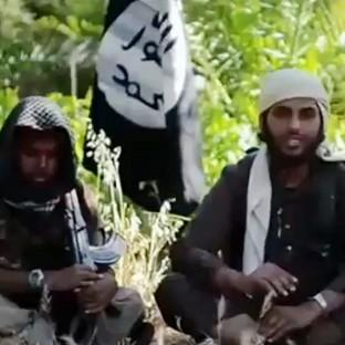 Screengrab taken from YouTube of a video showing Islamist fighters, who claim to be British, appearing in a recruitment video for the terrorist group Isis